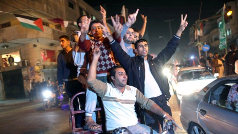 Palestinians celebrate the ceasefire between Israel and militant factions led by Hamas