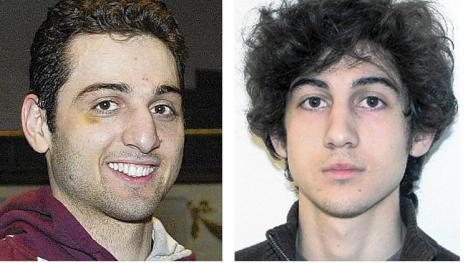 "Shortly before he was apprehended by authorities, Dzhokhar Tsarnaev, right, wrote that he was ""jealous"" of his slain brother, Tamerlan. ""I do not mourn because his soul is very much alive,"" he wrote, according to a court filing by federal prosecutors. (Associated Press)"