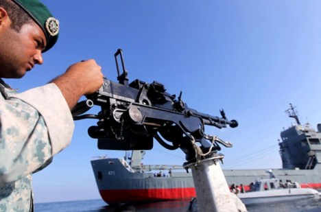 An Iranian soldier stands guard on a military speed boat during navy exercises in 2012.Photo: Getty Images