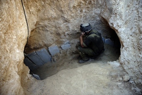 An Israeli soldier is seen at the entrance of a tunnel dug by Palestinians beneath the border between the Gaza Strip and Israel on October 13, 2013. ( DAVID BUIMOVITCH/AFP/Getty Images)