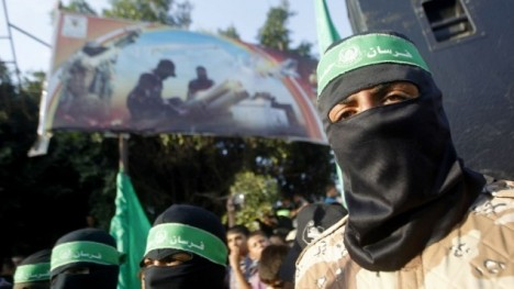 Palestinian masked supporters of the Islamist Hamas movement take part in a demonstration in Rafah in southern Gaza Strip earlier this month. (photo credit: AFP/SAID KHATIB)