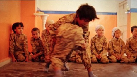 It is shows the young boys developing their hand-to-hand combat skills in the classroom