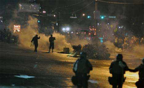 Police use tear gas during the first wave of the Ferguson unrest.