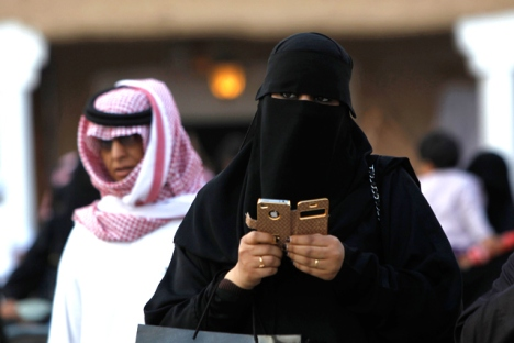 A Saudi Arabian woman on her cell phone. Saudi restaurant owners have begin to ban single women for objectionable behavior including use of a cell phone.